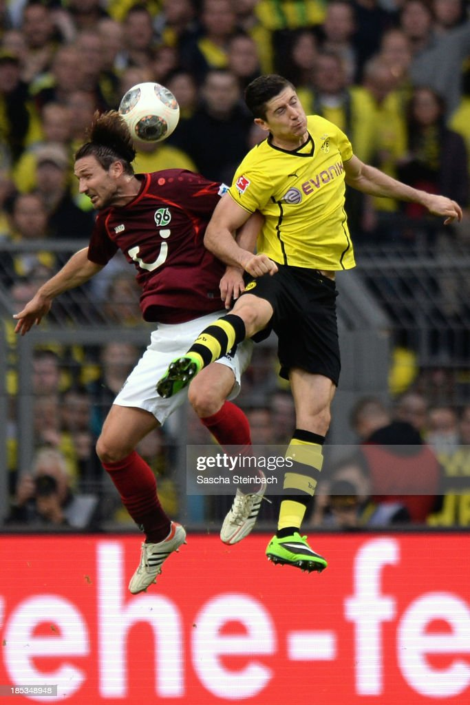 Christian Schulz of Hannover and Robert Lewandowski of Dortmund jump for a header during the Bundesliga match between Borussia Dortmund and Hannover...