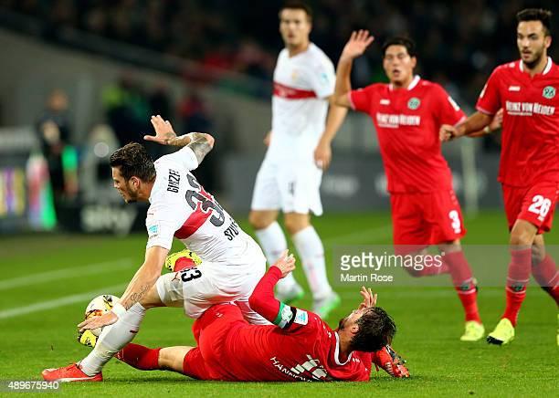 Christian Schulz of Hannover battles for the ball with Daniel Ginczek of Stuttgart during the Bundesliga match between Hannover 96 and VfB Stuttgart...
