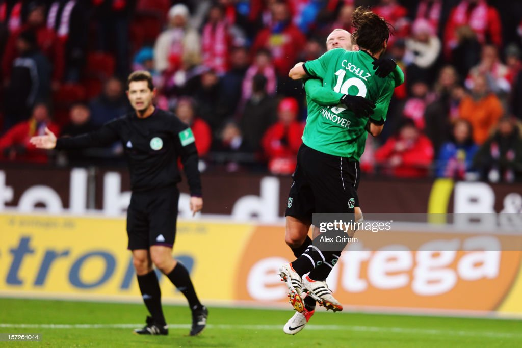 Christian Schulz of Hannover celebrates his team's first goal with team mate Konstantin Rausch during the Bundesliga match between 1 FSV Mainz 05 and...