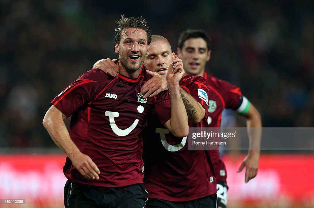 <a gi-track='captionPersonalityLinkClicked' href=/galleries/search?phrase=Christian+Schulz&family=editorial&specificpeople=228730 ng-click='$event.stopPropagation()'>Christian Schulz</a> of Hannover celebrates scoring his teams first goal with <a gi-track='captionPersonalityLinkClicked' href=/galleries/search?phrase=Leon+Andreasen&family=editorial&specificpeople=605829 ng-click='$event.stopPropagation()'>Leon Andreasen</a> of Hannover during the Bundesliga match between Hannover 96 and Hertha BSC at HDI Arena on October 04, 2013 in Hannover, Germany.