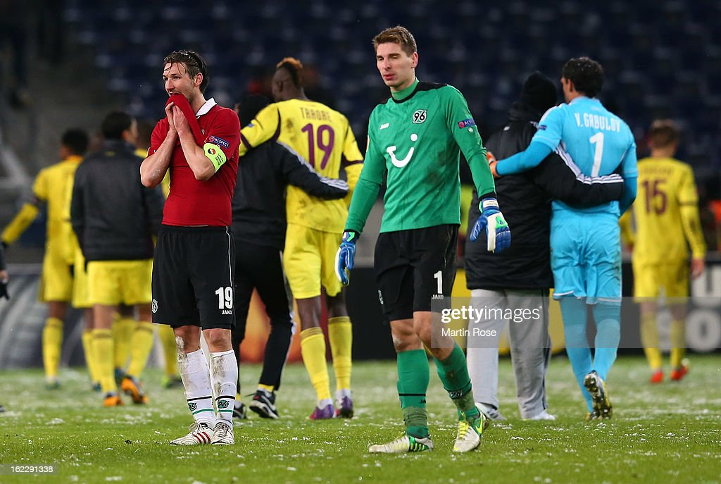 <a gi-track='captionPersonalityLinkClicked' href=/galleries/search?phrase=Christian+Schulz&family=editorial&specificpeople=228730 ng-click='$event.stopPropagation()'>Christian Schulz</a> (L) of Hannover looks dejected after the UEFA Europa League Round of 32 second leg match between Hannover 96 and Anji Makhachkala at AWD Arena on February 21, 2013 in Hannover, Germany.