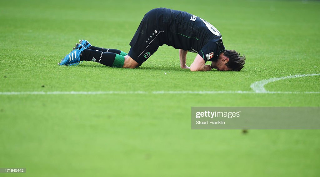 Christian Schulz of Hannover looks dejected during the Bundesliga match between VfL Wolfsburg and Hannover 96 at Volkswagen Arena on May 2 2015 in...