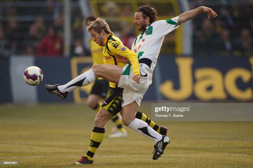 Christian Schulz of Hannover tackles Jakub 'Kuba' Blaszczykowski of Dortmund during the Bundesliga match between Borussia Dortmund and Hannover 96 at...