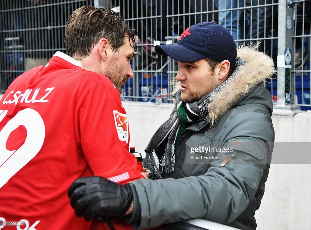 Christian Schulz of Hannover talks with an angry fans after the Bundesliga match between Hannover 96 and 1. FC Koeln at HDI-Arena on March 12, 2016 in Hanover, Germany.