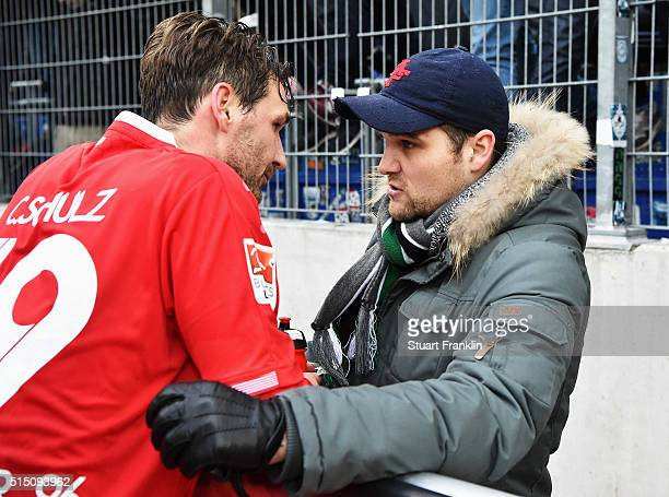 Christian Schulz of Hannover talks with an angry fans after the Bundesliga match between Hannover 96 and 1 FC Koeln at HDIArena on March 12 2016 in...