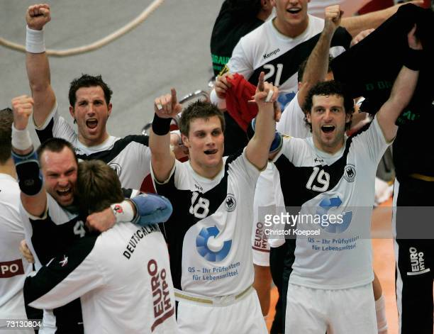 Christian Schwarzer Michael Kraus and Florian Kehrmann of Grmany celebrates 2926 victory of the Men's Handball World Championship Group I game...
