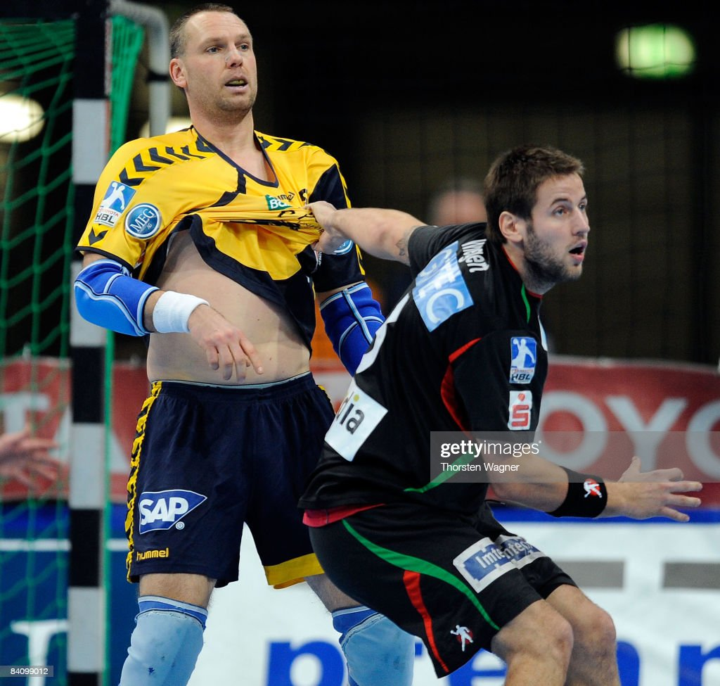 Christian Schwarzer (L) of Rhein Neckar Loewen is attacked by Bennet Wiegert (R) of Magdeburg during the Toyota Handball Bundesliga match between Rhein Neckar Loewen and SC Magdeburg at the SAP-Arena on December 20, 2008 in Mannheim, Germany.