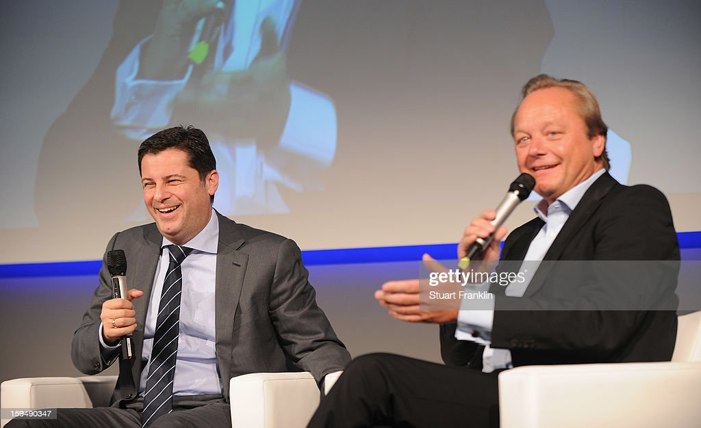 Christian Seifert, chairman of business for the DFL and Hanjo Schneider, CEO of Hermes europe at the announcement of Hermes as the new DFL premium sponsor on January 14, 2013 in Hamburg, Germany.