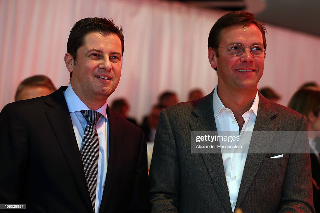 Christian Seifert (L), chairman of business for the DFL and James Murdoch, CEO News Corporation Europe and Asia, pose during the DFL new year's reception at the Thurn und Taxis Palais on January 15, 2013 in Frankfurt am Main, Germany.