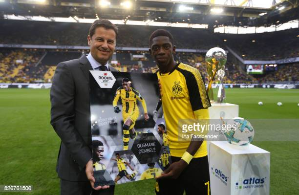 Christian Seifert DEO of the DFL honors Ousmane Dembele of Dortmund as 'Rookie 2017' player before the DFL Supercup 2017 match between Borussia...