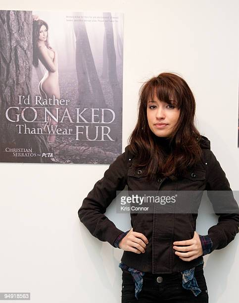 Christian Serratos poses for a photo during the unveiling of her PETA 'Fur I'd Rather Go Naked' poster at 3307 M St NW on December 19 2009 in...