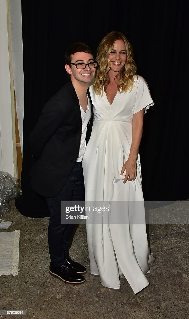 Christian Siriano and Alicia Silverstone pose backstage just before the start of the Christian Siriano show during Spring 2016 New York Fashion Week...