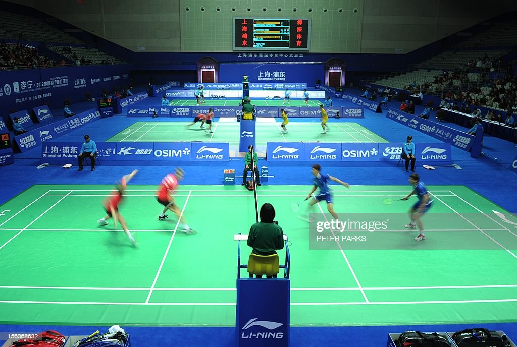 Christian Skovgaard and Mads Kolding of Denmark (L) play Ko Sung Hyun and Lee Yong Dae of Korea (R) during their men's doubles first round match at the China Open badminton tournament in Shanghai on November 14, 2012. AFP PHOTO / Peter PARKS