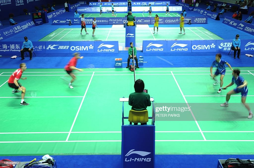 Christian Skovgaard and Mads Kolding of Denmark (L) play Ko Sung Hyun and Lee Yong Dae of Korea (R) during their men's doubles first round match at the China Open badminton tournament in Shanghai on November 14, 2012. AFP PHOTO/Peter PARKS