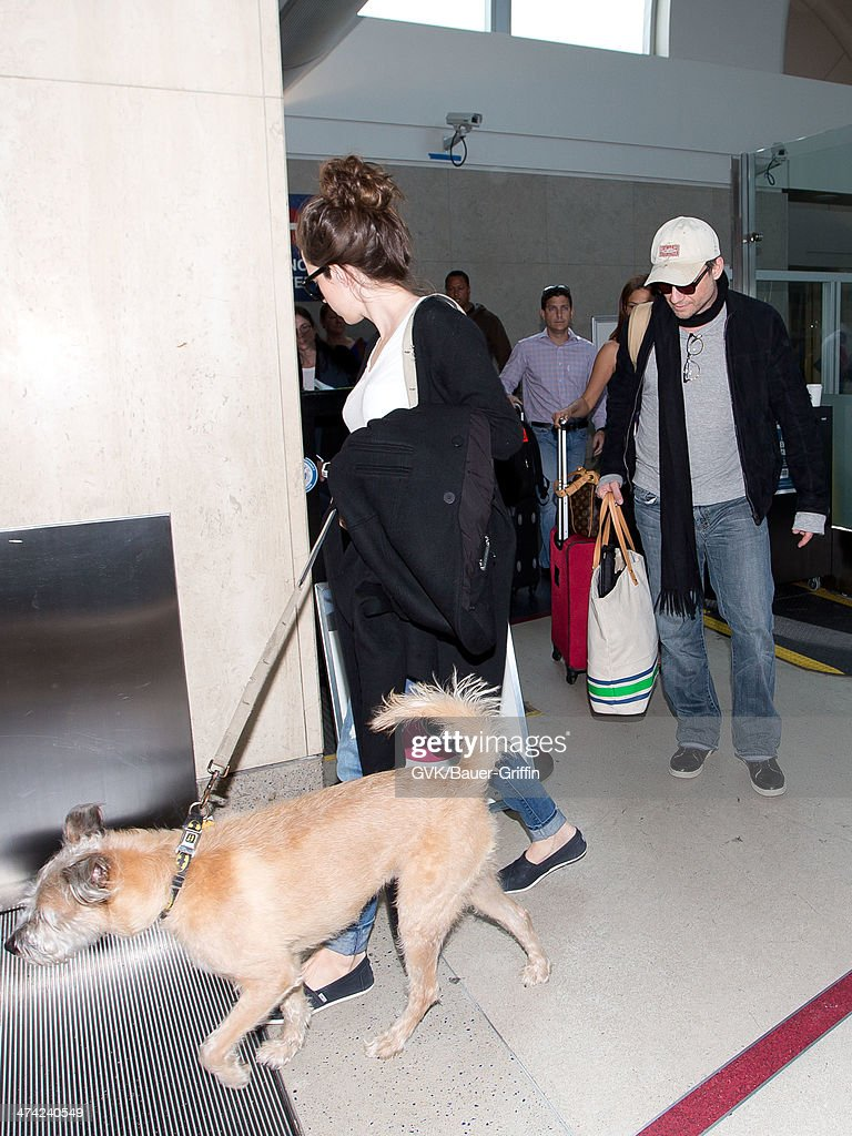 Christian Slater and Brittany Lopez seen at LAX airport on February 22, 2014 in Los Angeles, California.
