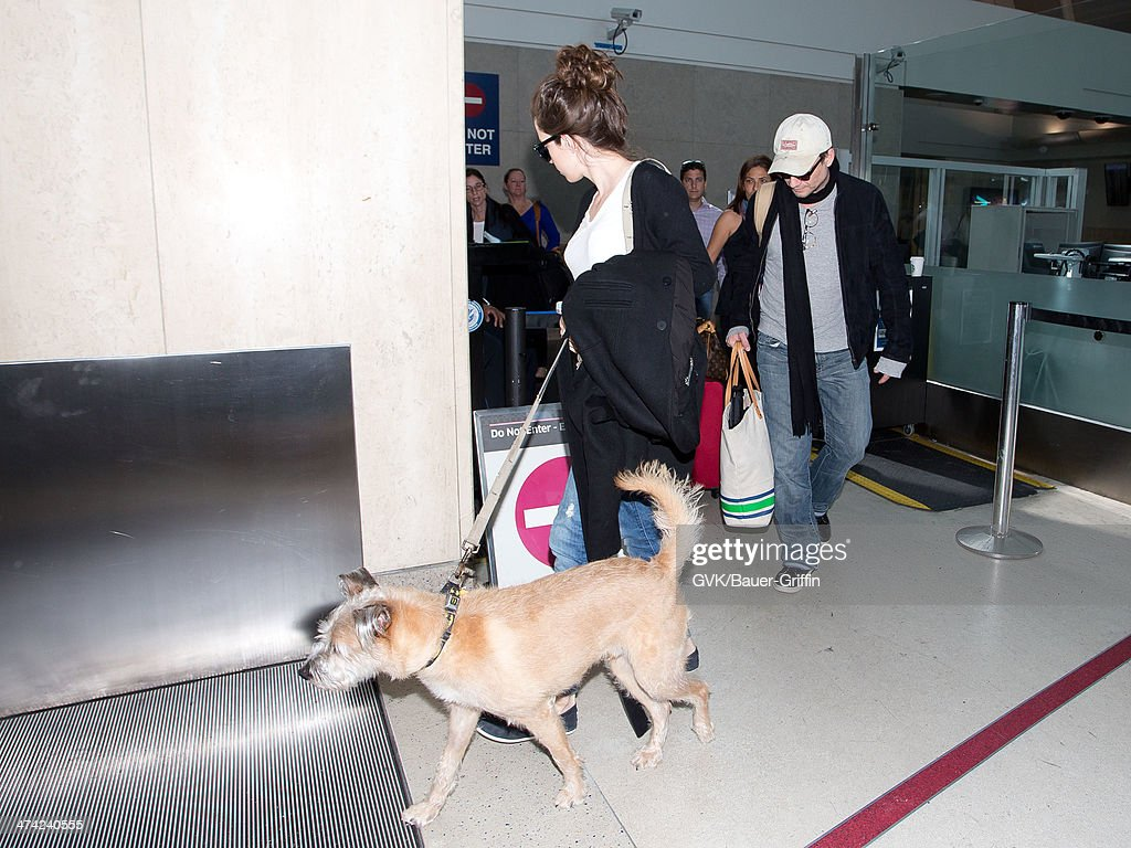 Christian Slater (R) and Brittany Lopez seen at LAX airport on February 22, 2014 in Los Angeles, California.
