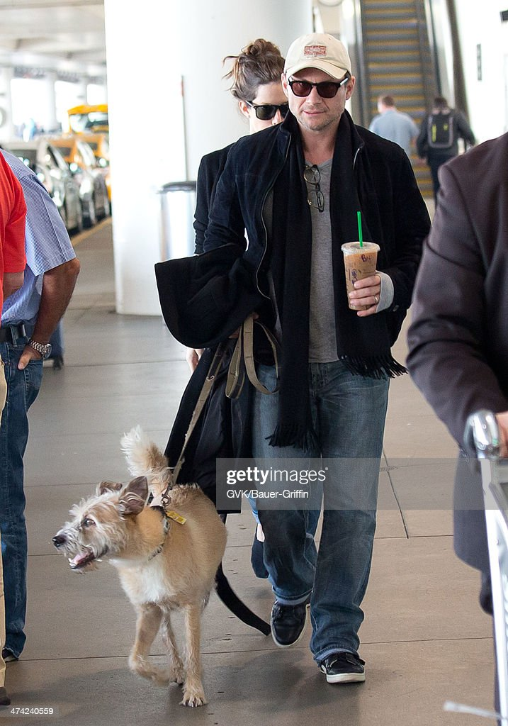 <a gi-track='captionPersonalityLinkClicked' href=/galleries/search?phrase=Christian+Slater&family=editorial&specificpeople=201651 ng-click='$event.stopPropagation()'>Christian Slater</a> and Brittany Lopez seen at LAX airport on February 22, 2014 in Los Angeles, California.