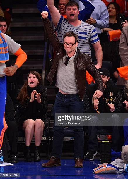 Christian Slater and daughter Eliana Sophia attend the Toronto Raptors vs New York Knicks game at Madison Square Garden on April 16 2014 in New York...