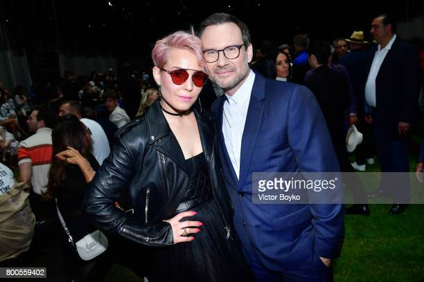Christian Slater and Noomi Rapace attend the Dior Homme Menswear Spring/Summer 2018 show as part of Paris Fashion Week on June 24 2017 in Paris France