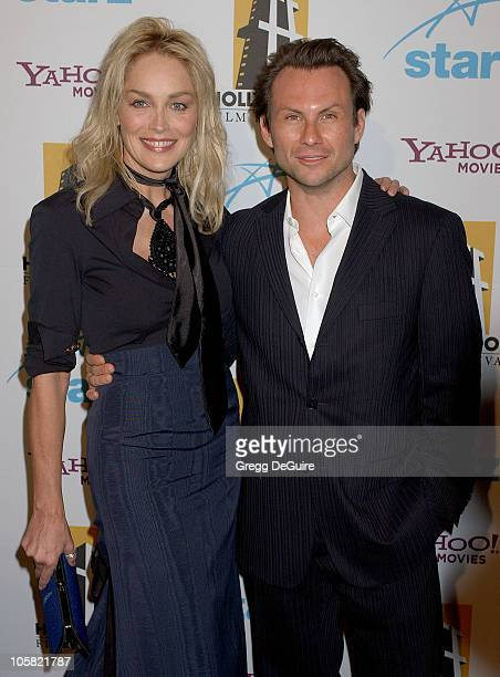 Christian Slater and Sharon Stone during Hollywood Film Festival 10th Annual Hollywood Awards Arrivals at The Beverly Hilton Hotel in Beverly Hills...