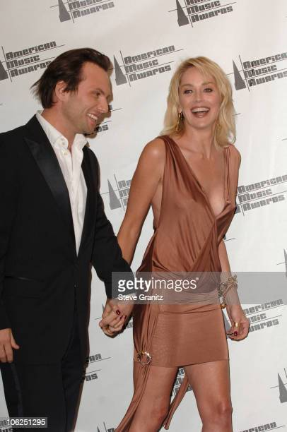 Christian Slater and Sharon Stone presenters during 2006 American Music Awards Press Room in Los Angeles California United States