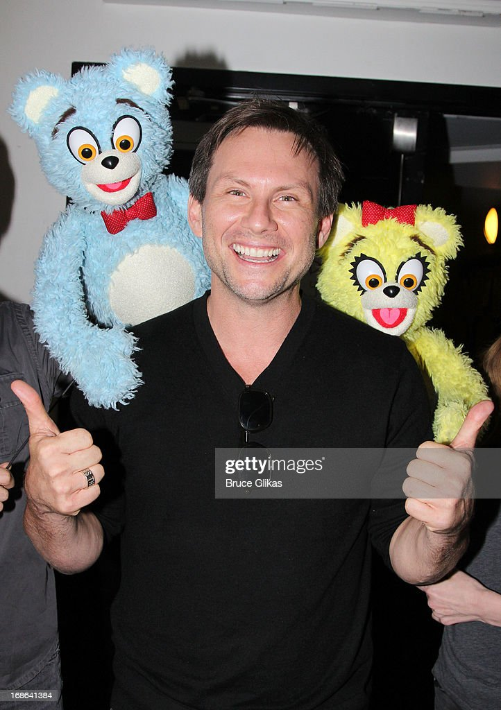Christian Slater and 'The Bad Idea Bears' pose backstage at the hit musical 'Avenue Q' on Broadway at The New World Stages on May 12, 2013 in New York City.