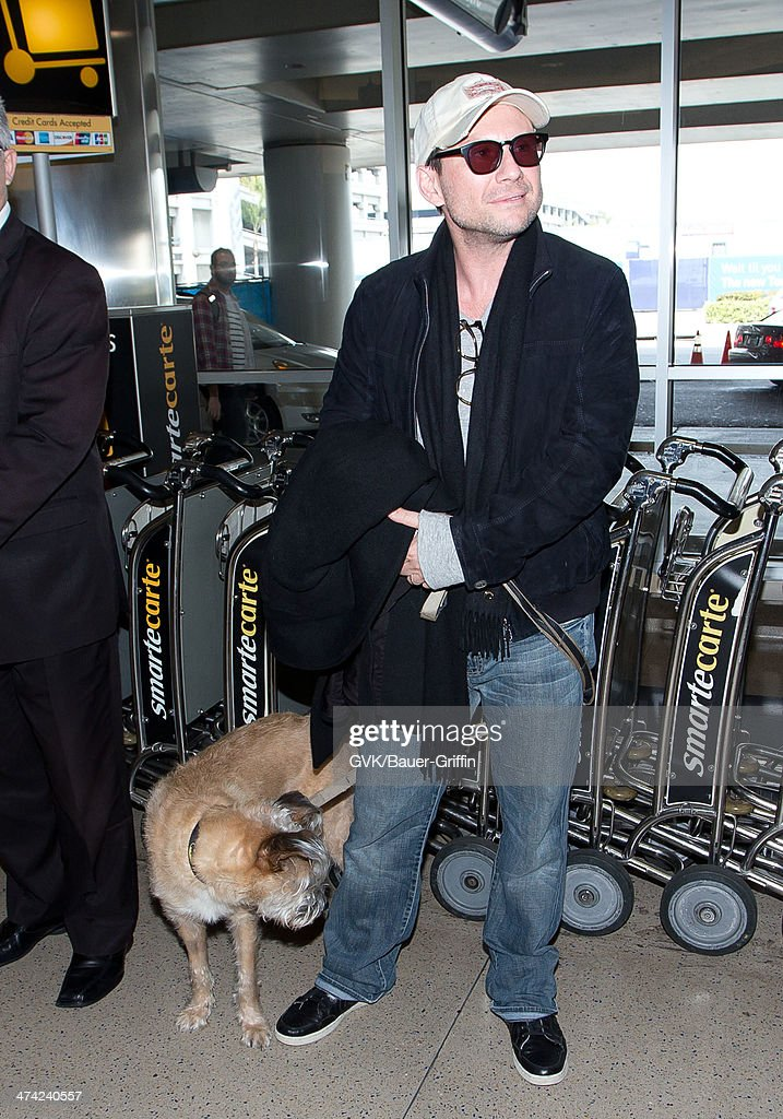 <a gi-track='captionPersonalityLinkClicked' href=/galleries/search?phrase=Christian+Slater&family=editorial&specificpeople=201651 ng-click='$event.stopPropagation()'>Christian Slater</a> seen at LAX airport on February 22, 2014 in Los Angeles, California.