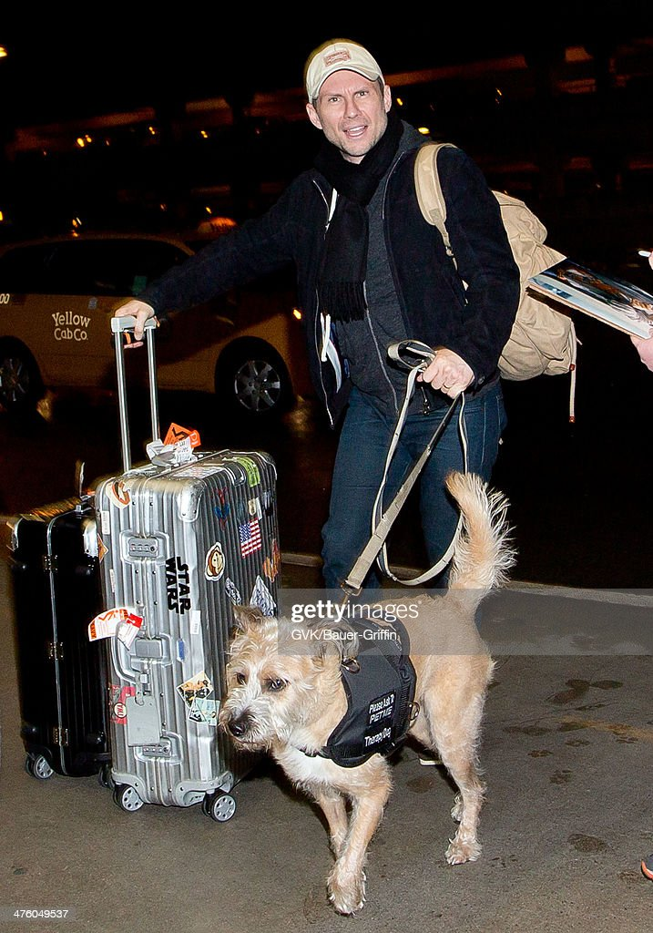<a gi-track='captionPersonalityLinkClicked' href=/galleries/search?phrase=Christian+Slater&family=editorial&specificpeople=201651 ng-click='$event.stopPropagation()'>Christian Slater</a> seen at LAX airport on March 01, 2014 in Los Angeles, California.