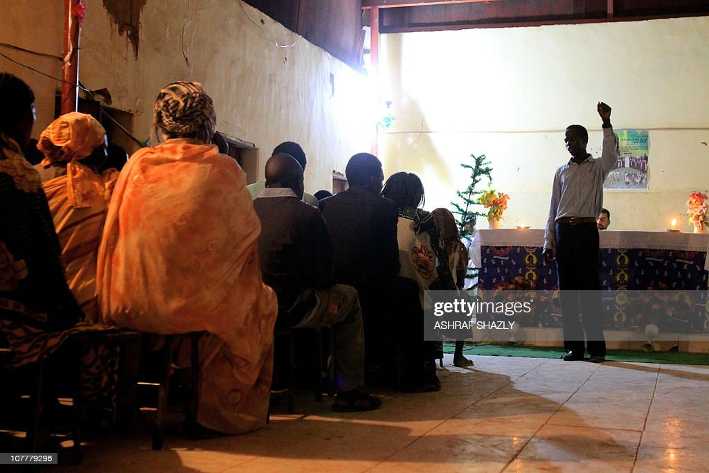 Christian southern Sudanese celebrate Christmas mass in the Soba district of southern Khartoum on December 25 as parishioners seek comfort fearful...