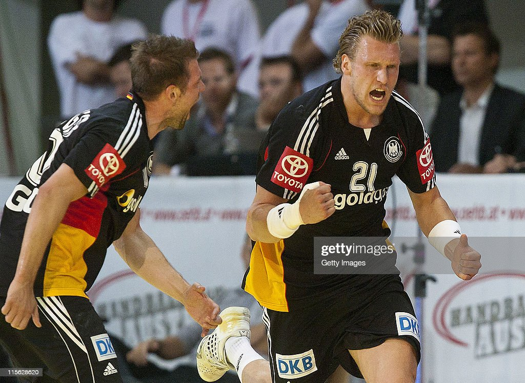 <a gi-track='captionPersonalityLinkClicked' href=/galleries/search?phrase=Christian+Sprenger+-+Handball+Player&family=editorial&specificpeople=635545 ng-click='$event.stopPropagation()'>Christian Sprenger</a> (L) and <a gi-track='captionPersonalityLinkClicked' href=/galleries/search?phrase=Lars+Kaufmann&family=editorial&specificpeople=579003 ng-click='$event.stopPropagation()'>Lars Kaufmann</a> of Germany celebrate during the Euro 2012 qualifier match between Austria and Germany at Olympiahalle on June 8, 2011 in Innsbruck, Austria.