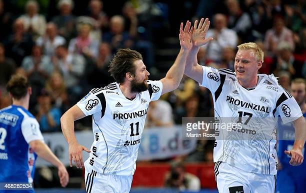 Christian Sprenger of Kiel celebrate with team mate Patrick Wiencek during the DKB HBL Bundesliga match between THW Kiel and Bergischer HC at...