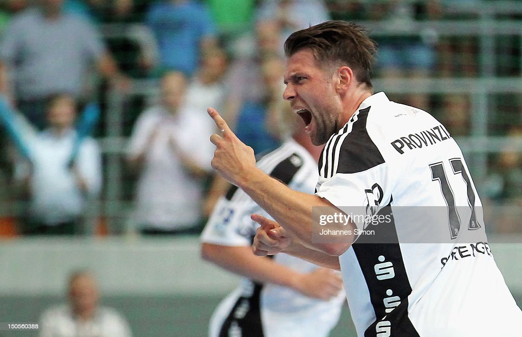 Christian Sprenger of Kiel celebrates after scoring a goal during the Handball Supercup match between THW Kiel and SG Flensburg Handewitt at Olympia Eishalle on August 21, 2012 in Munich, Germany.