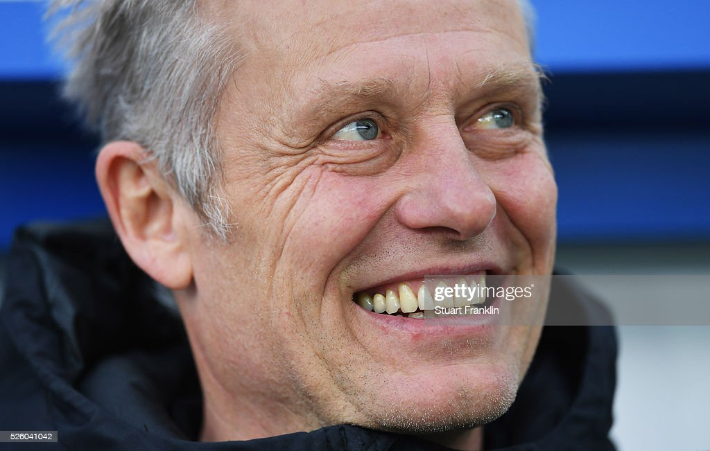 <a gi-track='captionPersonalityLinkClicked' href=/galleries/search?phrase=Christian+Streich&family=editorial&specificpeople=4411796 ng-click='$event.stopPropagation()'>Christian Streich</a>, head coach of Freiburg looks happy during the second Bundesliga match between SC Paderborn and SC Freiburg at the Benteler Arena on April 29, 2016 in Paderborn, North Rhine-Westphalia.