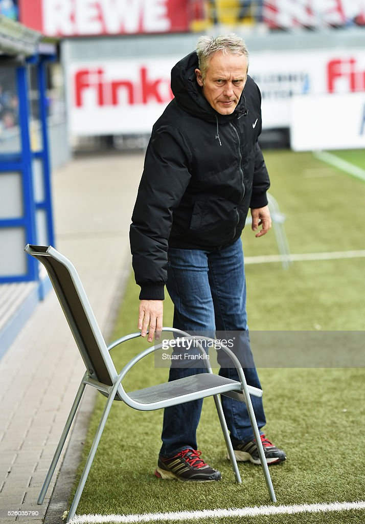 <a gi-track='captionPersonalityLinkClicked' href=/galleries/search?phrase=Christian+Streich&family=editorial&specificpeople=4411796 ng-click='$event.stopPropagation()'>Christian Streich</a>, head coach of Freiburg moves a chair during the second Bundesliga match between SC Paderborn and SC Freiburg at the Benteler Arena on April 29, 2016 in Paderborn, North Rhine-Westphalia.