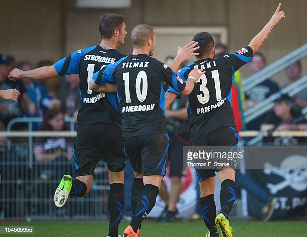 Christian Strohdiek Deniz Yilmaz and Deniz Naki of Paderborn celebrate their teams first goal during the Second Bundesliga match between SC Paderborn...