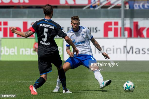 Christian Strohdiek of Paderborn and Guido Burgstaller of Schalke battle for the ball during the preseason friendly match between SC Paderborn and FC...