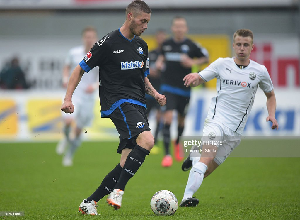 Christian Strohdiek (L) of Paderborn and Marco Thiede of Sandhausen fight for the ball during the Second Bundesliga match between SC Paderborn and SV Sandhausen at Benteler Arena on April 27, 2014 in Paderborn, Germany.