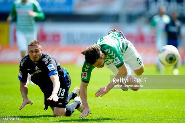 Christian Strohdiek of SC Paderborn challenges Ilir Azemi of Greuther Fuerth during the Second Bundesliga match between SC Paderborn and Greuther...