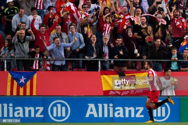 Christian Stuani of Girona FC celebrates after scoring his team's first goal during the La Liga match between Girona and Real Madrid at Estadi de...