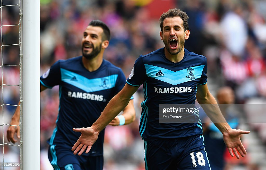 Christian Stuani of Middlesbrough celebrates scoring the opening goal with Alvaro Negredo (L) during the Premier League match between Sunderland and Middlesbrough at Stadium of Light on August 21, 2016 in Sunderland, England.