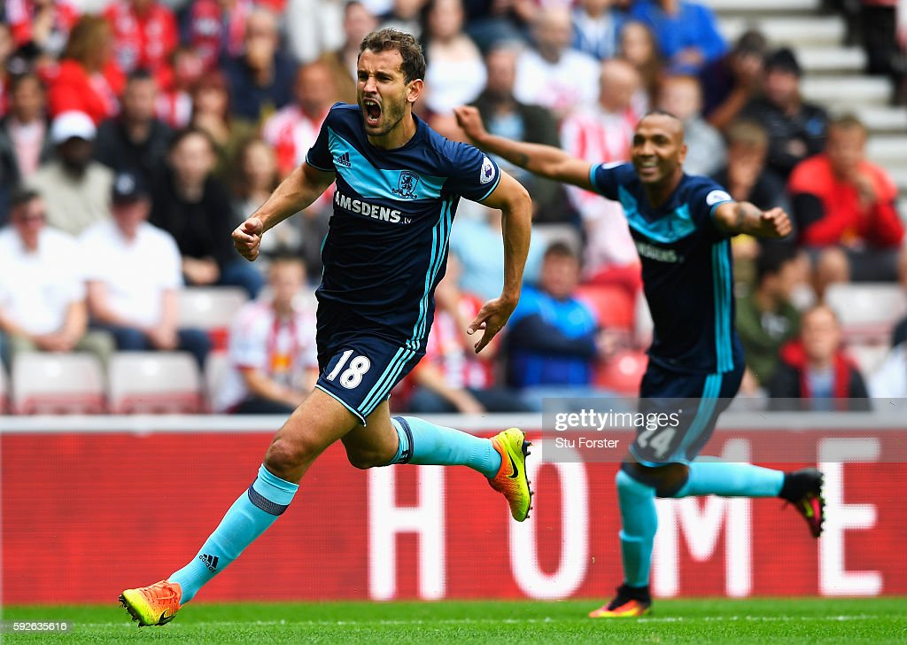 Christian Stuani of Middlesbrough celebrates scoring the opening goal with Emilio Nsue (R) during the Premier League match between Sunderland and Middlesbrough at Stadium of Light on August 21, 2016 in Sunderland, England.