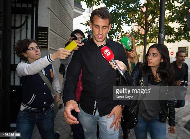 Christian Stuani of RCD Espanyol and formerly of Levante UD is surrounded by journalists outside the Spanish AntiCorruption headquarters on October 3...