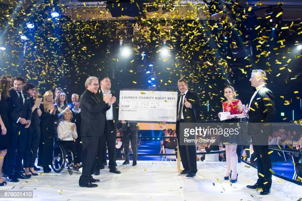 Christian Stucki winner of this year's 'Unspunnen Schwinget' presents the Laureus Foundation Switzerland with a cheque of almost CHF 3 000 000 during...