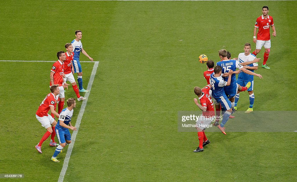 Christian Stuff (C) of Rostock jumps for a header during the Third league match between 1. FSV Mainz 05 II and Hansa Rostock at Bruchweg Stadium on August 29, 2014 in Mainz, Germany.