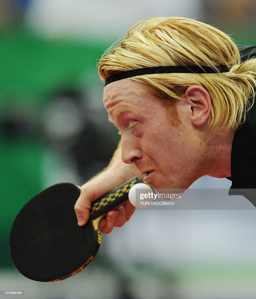 Christian Suss of Germany serves to Se Hyuk Joo of Korea during the men's semi final at the 2010 World Team Table Tennis Championships in Moscow on May 29, 2010.
