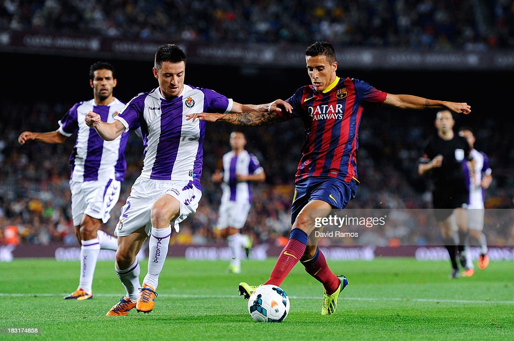 Christian Tello of FC Barcelona duels for the ball with Antonio Rukavina of Real Valladolid CF during the La Liga match between FC Barcelona and Real Valladolid CF at Camp Nou on October 5, 2013 in Barcelona, Spain.