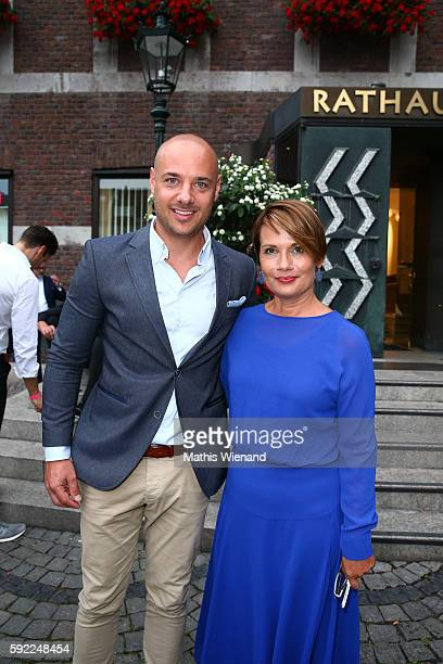 Christian Tewes and Jenny Juergens attend the Herzwerk Vernissage 'auf den 2ten Blick' at City Hall on August 19 2016 in Duesseldorf Germany