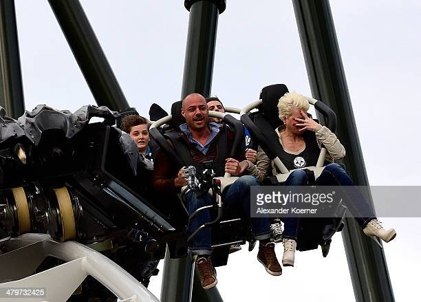 Christian Tews and Melanie Mueller are pictured during the opening of the new wing coaster 'Flug der Daemonen' at Heidepark on March 20 2014 in...