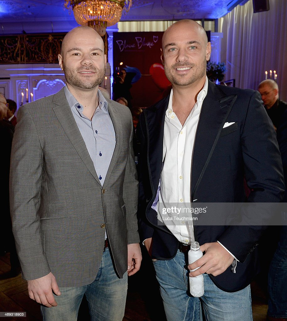 Christian Tews (R) from the TV Show 'The Bachelor 2014' and his brother Daniel attend the Blaue Blume Awards during 64th Berlinale International Film Festival on February 14, 2014 in Berlin, Germany.
