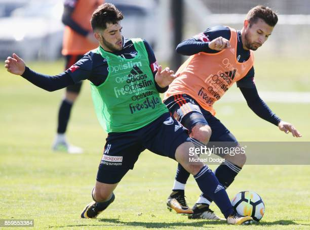 Christian Theoharous and Kosta Barbarouses compete for the ball during a Melbourne Victory ALeague training session at Gosch's Paddock on October 10...